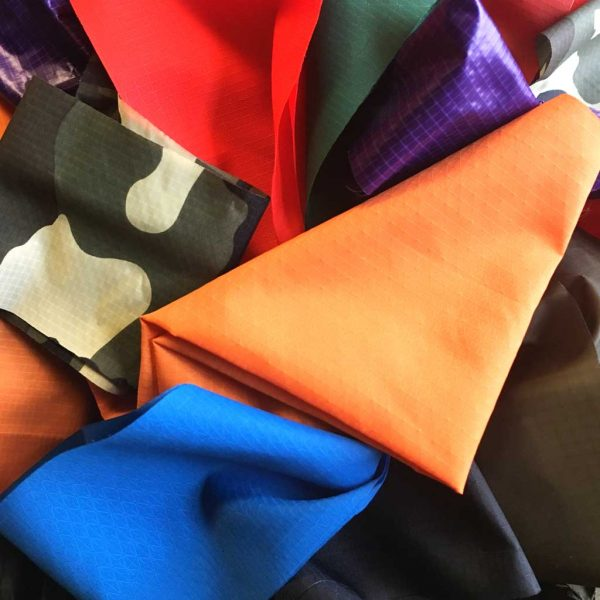 a collection of different camping fabrics