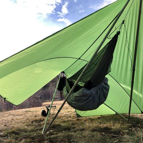 hammock underneath green tent