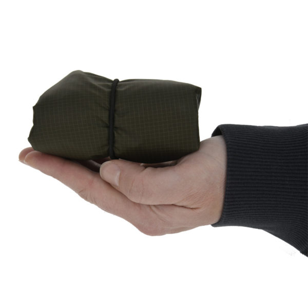 green garment bag in palm of hand