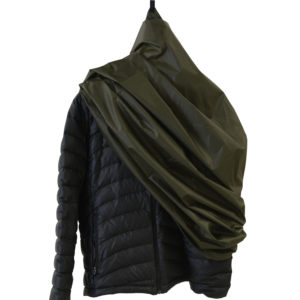 green garment folded on black jacket