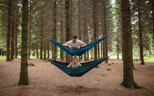 couple on hammocks in tree