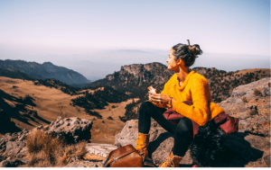 woman eating while on a hike